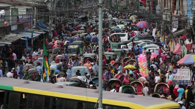 traffic jam and peoples crowd seen at new market area during the ramadan in dhaka , bangladesh on june 12, 2018. last 10 years in dhaka, average... - population explosion stock videos & royalty-free footage