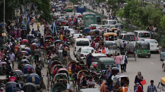 traffic jam and peoples crowd seen at new market area during the ramadan in dhaka bangladesh on june 12 2018 last 10 years in dhaka average traffic... - population explosion stock videos and b-roll footage