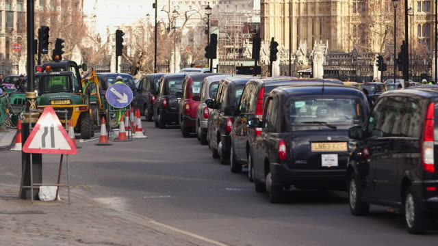 ws traffic jam and road construction at parliament square / london, england, united kingdom - traffic stock videos & royalty-free footage