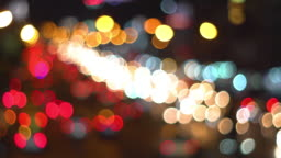 Traffic jam at night with defocused light mode