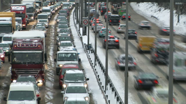 Traffic jam in a blizzard (snow fall) - Timelapse