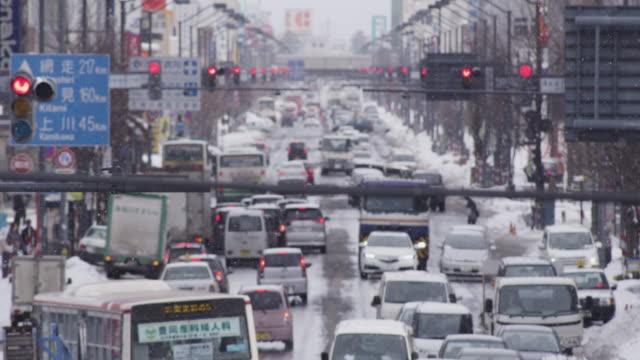 traffic jam in a japanese city - asahikawa stock videos & royalty-free footage