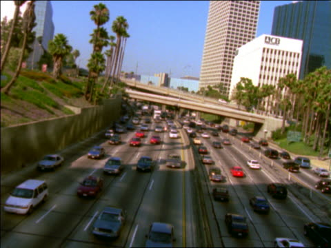 vidéos et rushes de traffic jam in both directions on highway / los angeles, california - 1990 1999