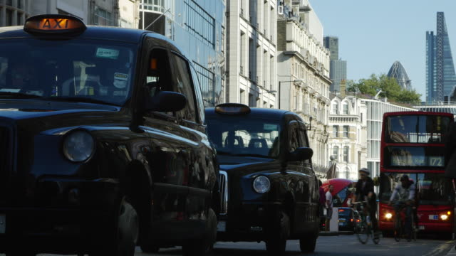 traffic jam in london fleet street (uhd) - uk stock videos & royalty-free footage