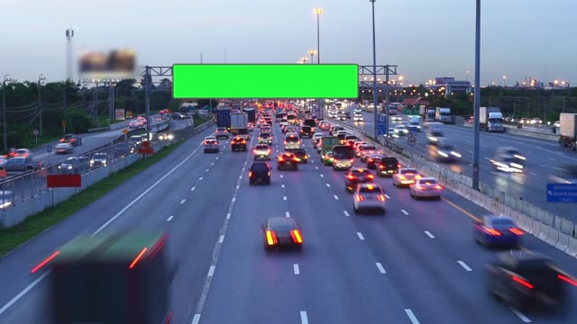 traffic jam on expressway with billboard green screen. - road sign stock videos & royalty-free footage