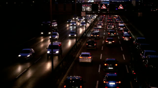 traffic jam on highway at night, real time - sign stock videos & royalty-free footage