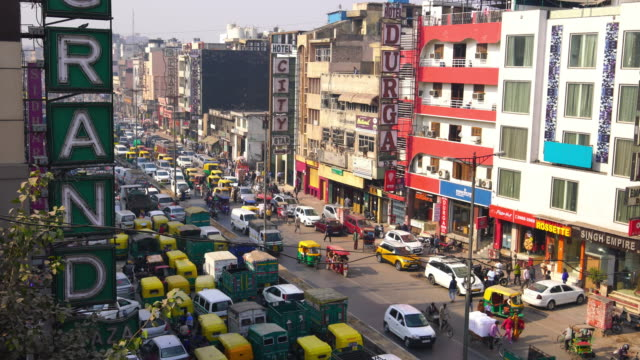 traffic jam on the polluted streets of new delhi in india - delhi stock videos & royalty-free footage