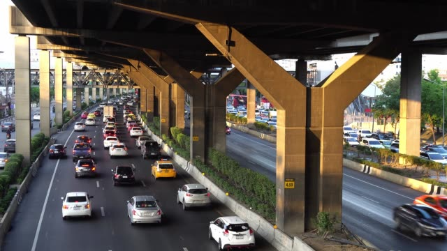 traffic jam on vibhavadi rangsit road evening with sunlight in bangkok, thailand. - bumper stock videos & royalty-free footage