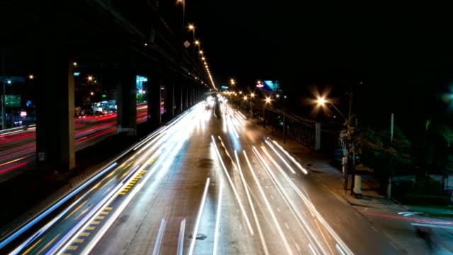 traffic jam (borommaratchachonnani road) rush hour at night time in bangkok. - traffic light stock videos & royalty-free footage