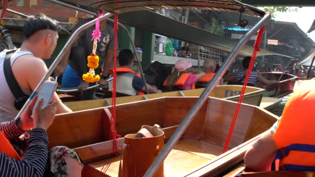 traffic jam with boats on a narrow canal the damnoen saduak floating market - exoticism stock videos & royalty-free footage