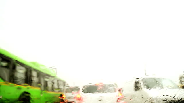 traffic jan during rainy season - saving up for a rainy day stock videos and b-roll footage
