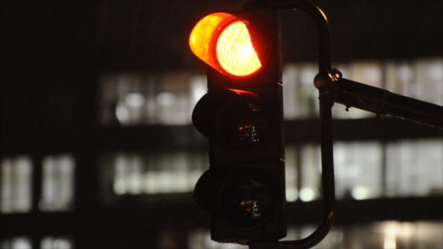 traffic light at night, turning green (hd720p) - green light stoplight stock videos and b-roll footage