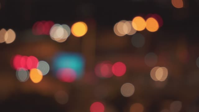 traffic light at night with defocused mode - headlight stock videos & royalty-free footage