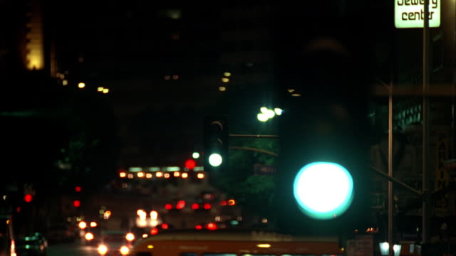 a traffic light changes from green to yellow. - green light stock videos & royalty-free footage