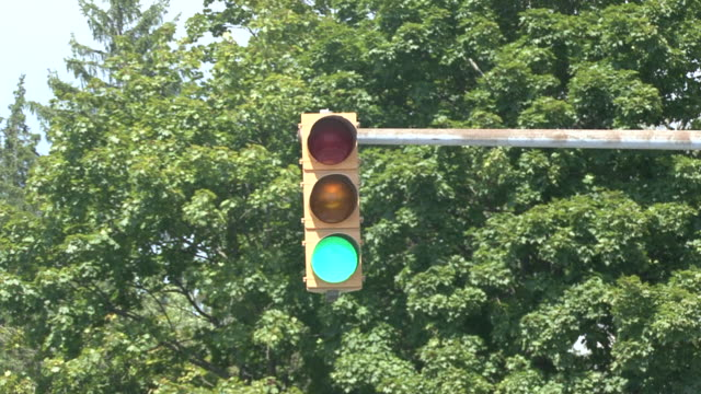 traffic light changing from green to red, from go to stop - green light stoplight stock videos and b-roll footage