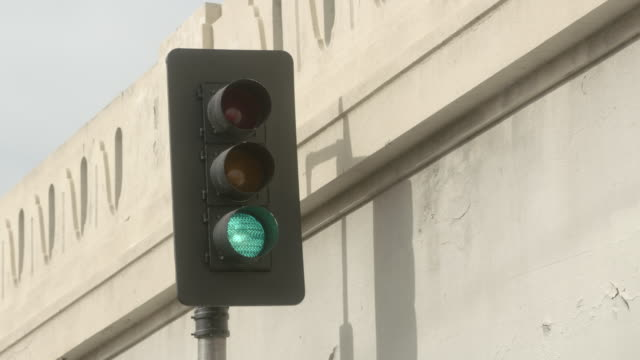 ms traffic light changing from green to red / los angeles, california, united states - green light stoplight stock videos and b-roll footage