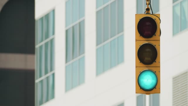 traffic light in an american city street - stop sign stock videos & royalty-free footage