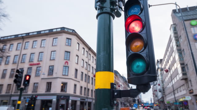 traffic light intersection in stockholm, sweden - traffic light stock videos & royalty-free footage