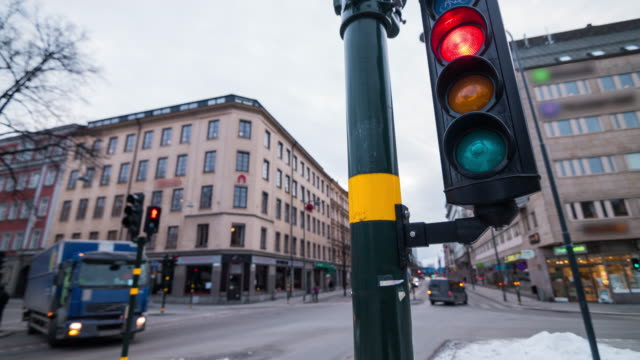 traffic light intersection in stockholm, sweden - segnaletica stradale video stock e b–roll