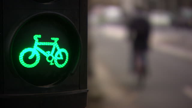 traffic light with bike sign for cyclists on cycle lane at the embankment, london - road signal stock videos & royalty-free footage
