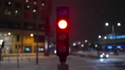 Traffic Lights at Night in Snowy Weather