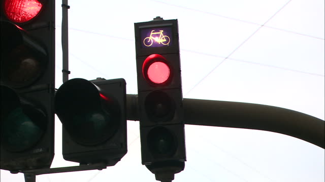 Traffic lights change for bicyclists and motorists.