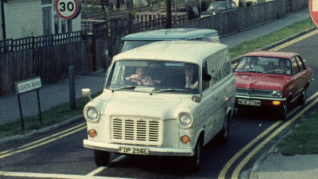 1974 montage traffic lights controlling the flow of traffic at busy intersections / southampton, hampshire, england - hampshire england stock videos and b-roll footage