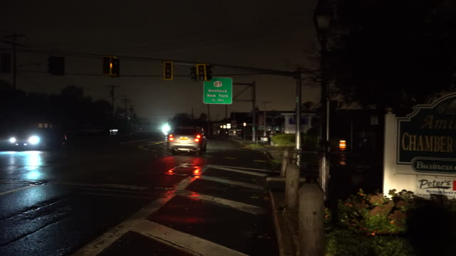 Traffic lights go dark as a powerful night time nor'easter on Long Island causes a power outage in the town of Amityville New York