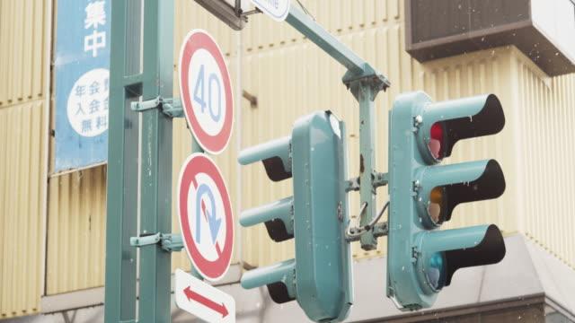 traffic lights in asahikawa, japan - asahikawa stock videos & royalty-free footage