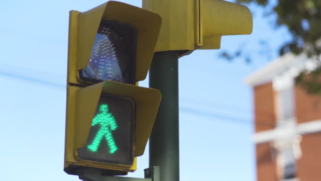 traffic lights pedestrian crossing goes in green from red - pedestrian stock videos & royalty-free footage