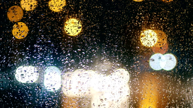 traffic lights, rain drops, passing cars, night - bedtime stock videos and b-roll footage