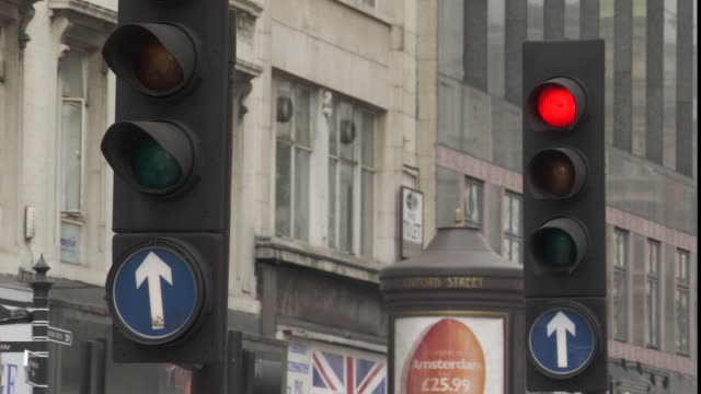 ms traffic lights turning from red to green at oxford street / london, london, uk - 2006 stock videos & royalty-free footage