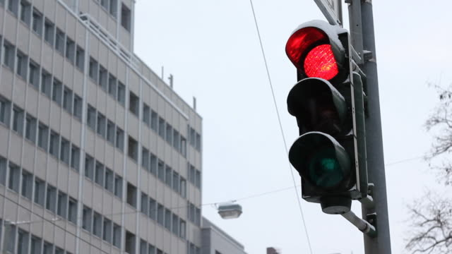 Traffic lights turning green in winter Germany
