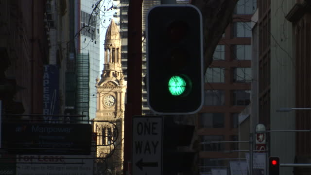 cu, traffic lights with town hall clock tower in background, sydney, australia - traffic light stock videos & royalty-free footage