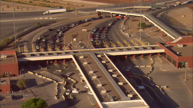 aerial traffic lined up at border crossing at us/mexican border, city of juarez in distance, el paso, texas, usa - border stock videos & royalty-free footage