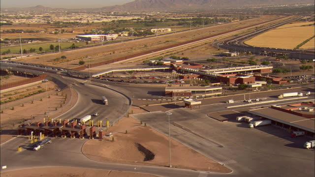 AERIAL Traffic lined up at border crossing at US/Mexican border, El Paso, Texas, USA