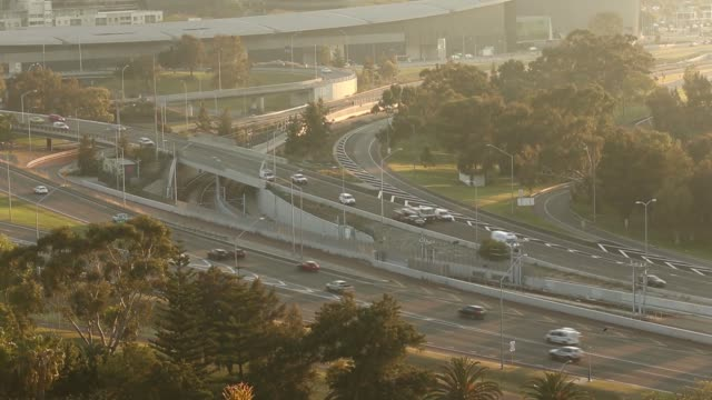 Traffic move along a highway as skyscrapers stand in the central business district at sunrise in Perth Australia on Friday Oct 28 Traffic move along...