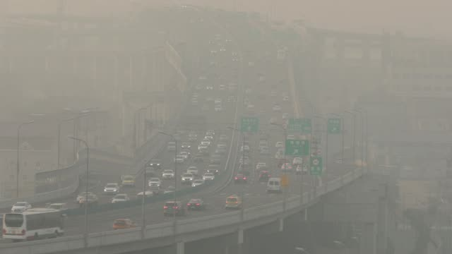 traffic move along an elevated road shrouded in haze on the outskirts of shanghai, china, on thursday, feb. 8, 2018 - luftverschmutzung stock-videos und b-roll-filmmaterial