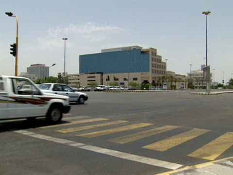 traffic moves across a junction, jeddah; 1996 - jiddah stock videos & royalty-free footage
