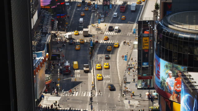 traffic moves across broadway and seventh avenue in new york's times square. - broadway manhattan stock videos and b-roll footage