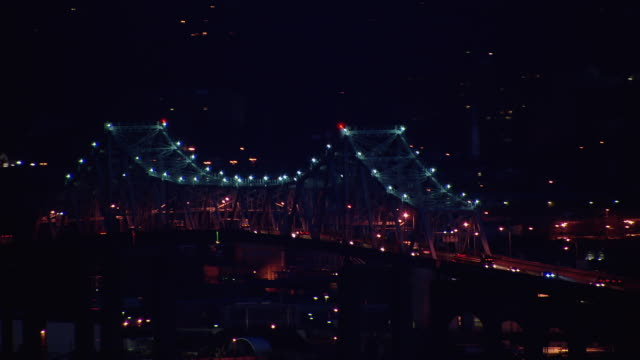 traffic moves across goethals bridge  between elizabeth, new jersey and staten island, new york city at night. - staten island stock videos and b-roll footage