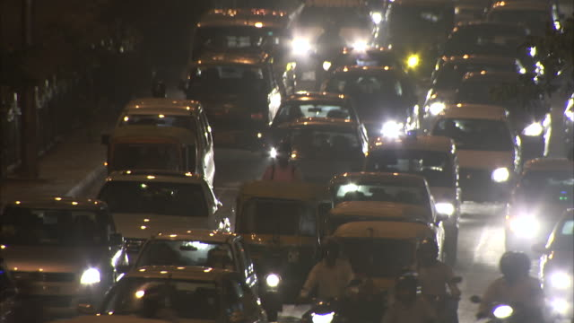 traffic moves along a busy street in delhi, india. - traffic jam stock videos & royalty-free footage