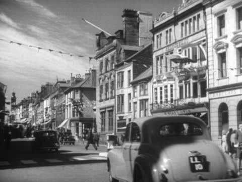 traffic moves along a high street in aberystwyth - aberystwyth stock videos & royalty-free footage