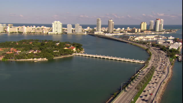 traffic moves along a highway across miami's biscayne bay. - biscayne bay stock videos & royalty-free footage
