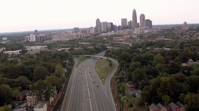 traffic moves along a highway heading toward downtown charlotte, north carolina. - charlotte north carolina stock videos & royalty-free footage