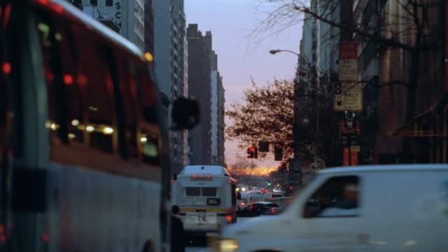 traffic moves along a new york city street at golden hour. - 2001 stock videos & royalty-free footage