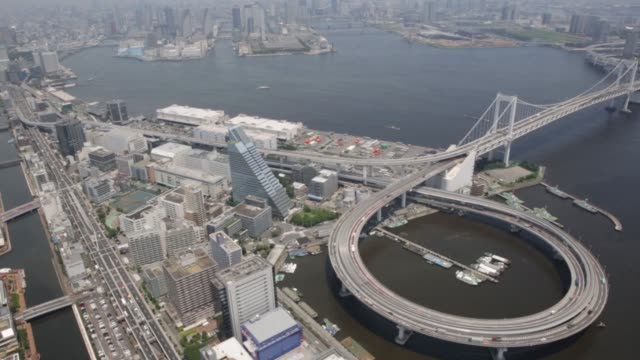 vídeos de stock, filmes e b-roll de traffic moves along a ramp leading to the rainbow bridge in this aerial shot taken in tokyo japan on wednesday june 24 2015 - produto interno bruto