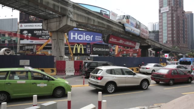 Traffic moves along a road below a KL Monorail elevated track operated by Rapid Rail Sdn Bhd in Kuala Lumpur Malaysia on Friday Aug 5 Traffic moves...