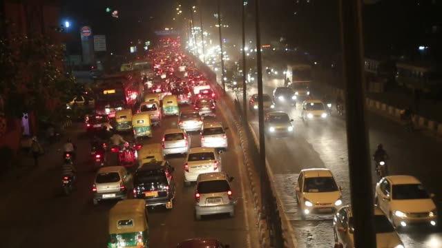 Traffic moves along a street during the evening rush hour outside Nehru Place business complex in New Delhi India on Wednesday Nov 27 2013...