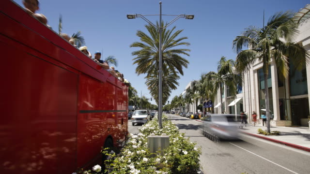 Traffic moves along both sides of Rodeo Drive in Beverly Hills.